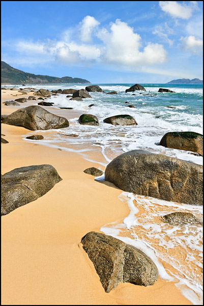 Tropical beach with rocks in Sanya, Hainan Island