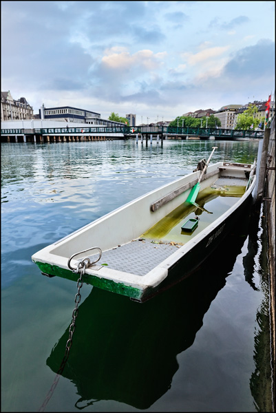 moored flat bottom boat in Zurich old town