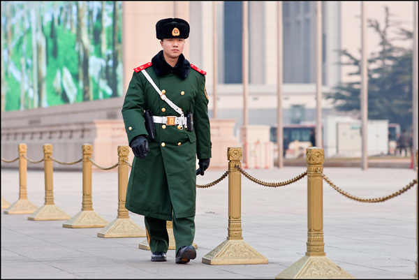 Honor guard marches close to the mausoleum of Mao Zedong